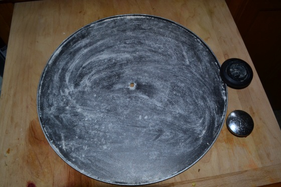 The cover of my wok. I unscrewed the handle part and floured it up and it worked great as a stand in pizza pan LOL