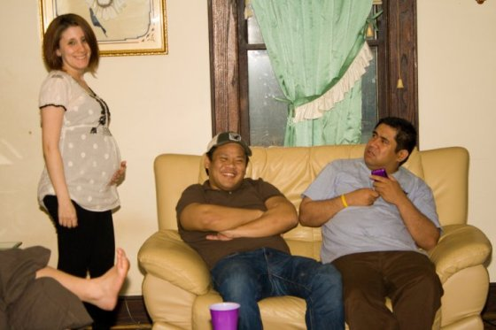 A very pregnant me...and my husband giving me a very strange look lol