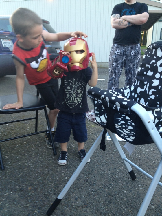 My son playing with the other neighborhood kids, he was pretending to be iron man.